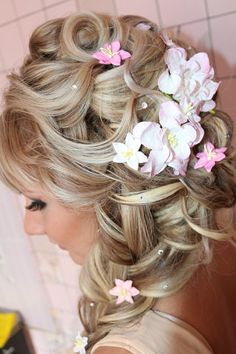 Cute little side braid hairstyle.  I love the flowers incorporated with it as well.