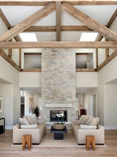 PIN 9: The natural grey stone in this floor to ceiling fireplace works well with the rustic design of this living room space. The room is well balanced, with the fireplace being the magnificent focal point.