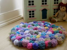 Beautiful Home-made Pompom rug for my Beautiful daughter.