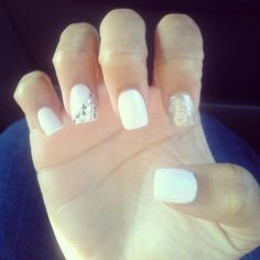 Classic white nails with glitter and jewels.
