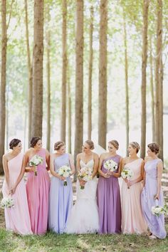 LOVE these bridesmaid dresses. All the same dress, just different shades of pink and purple.