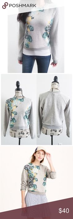 """J. Crew Aquatic Floral Cropped Sweatshirt This sweater shirt has a fresh floral print named """"aquatic floral"""" by J.crew. It's a beautiful fresh look that can be dressed up or Down{I am not a professional photographer, actual color of item may vary ➾slightly from pics}  ❥chest:19.5"""" ❥waist:17"""" ❥length:20"""" ❥sleeves:28"""" ➳material/care:cotton + machine wash  ➳fit:like an xs  ➳condition:good no rips/stains  ✦20% off bundles of 3/more items/No returns ✦No Trades  ✦NO HOLDS ✦No transactions outside…"""