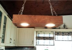 Wooden hanging ceiling light made from first quality 1,6cm thickness plywood Have 2 recessed 7 watt leds with total 1540 - 1700 lumens. Very low electricity cost with only 14 watt total. It is perfect for lighting kitchen table or bar. This light it is ready to hang with one hook. It is sanded carefully and finished with only water stain.
