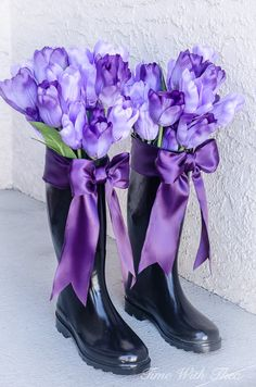 Upcycled Ugly Rain Boots turn Into Gorgeous Spring Decorated Vases