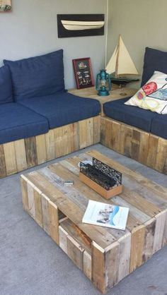 Pallet coffee table on wheels with storage.