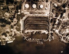 80-G-182878: Pearl Harbor, Territory of Hawaii, October 16, 1941. Aerial view showing the fuel depot, coal docks, and upper tank farm, Navy Yard, Pearl Harbor, taken by aircraft from Naval Air Station, Pearl Harbor. (9/9/2015).