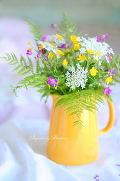 Wild Flowers in a yellow pitcher!