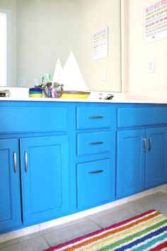 learn how to paint your 1990s oak vanity for under $100 (with new hardware!). fun project for a kids' bathroom | via Tag&Tibby