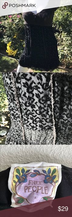 Free People Black Crochet Knit Boho Chic Dress Sz2 Free People Black Crochet Knit Boho Chic Dress Sz 2 Velvet Sheer Skirt  Details: Ties at back Side zipper Skirt is lined Cap sleeves Knitted top Free People Dresses Mini