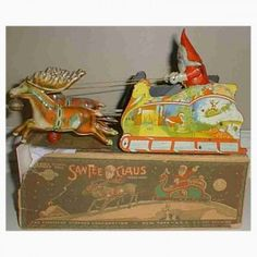 Strauss Tin-Carriages Santee Claus in Sleigh wind-up toy, this brightly lithograph