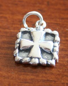 This sterling silver Framed Cross Charm will make a great keepsake religious jewelry gift for someone wanting to express their Christian faith, a Confirmation gift, Baptism gift, First Communion Gift, Reconciliation gift, mom necklace, or wedding gift.