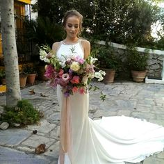 Stunning bride Lisa with her summer-inspired bouquet adorned with Corcortez's silk ribbons