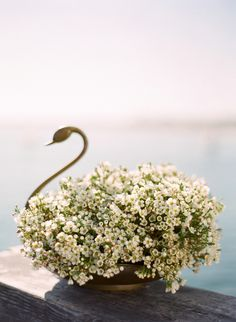 Bronze swan and Baby's Breath little flowers. Sail away with me wedding decoration idea. Jose Villa Photo.