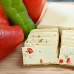 Vegan Pepperjack Cheese ½ cup raw cashews ½ cup unsweetened almond milk 3 Tbsp lemon juice 2 Tbsp tahini ¼ cup nutritional yeast 1 tsp kosher or sea salt 1½ tsp onion powder ½ tsp garlic powder 1 cup water 2 Tbsp agar powder 1 cup peppers, diced