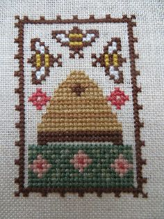 Bee Skep by The Prairie Schooler, stitched by Garden Grumbles and Cross Stitch Fumbles.