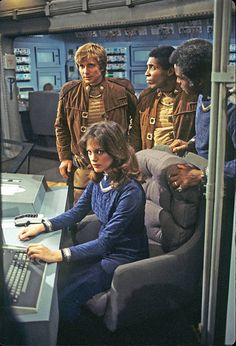 Maren Jensen as Athena flanked by Dirk Benedict (Starbuck), Herb Jefferson Jr. (Boomer) and Terry Carter (Colonel Tigh) in Battlestar Galactica Best Sci Fi Shows, 70s Tv Shows, Sci Fi Tv Shows, Sci Fi Movies, Movie Tv, Maren Jensen, Kampfstern Galactica, Battlestar Galactica 1978, Science Fiction Art