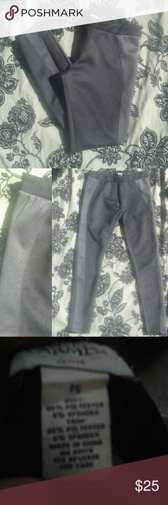 """Gray jeggings Great quality, comfortably and stylish. Dark gray color, with a snakes with sheet overlay stripe on the side, and a mock zipper.  Length:34"""" Carmen Marc Valvo Pants Leggings"""
