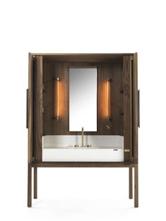 This Italian-style vanity credenza lets you bring the warmth of wood to your bathroom or bath space.  Photo 7 of 9 in 7 Stylish Bathroom Sinks That Can Fit in Even the Tiniest of Spaces