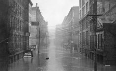 Downtown Cincinnati scenes from the January, 1937 Ohio River flood. Photographs by Nelson Ronsheim.