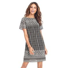 "Boho Print Shift Dress Relaxed Boho print dress designed to fall above the knee.  Zipper at center back for easy on/off fit.  Polyester.  New in original packaging.  Size Medium 10/12 Bust 35.5"" - 37.5""  Waist 27.5"" - 29.5""  Hip 38"" - 40"" Boutique Dresses"