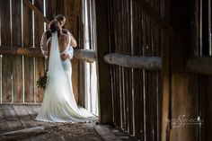 old barn outside perth ontario was the perfect spot to climb around in to get the perfect wedding location shot especially near the cracks in the walls