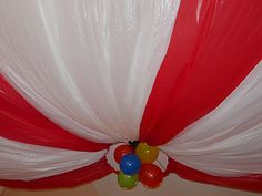 Great idea for a decoration idea (using a hoop & cheap white & red plastic tablecloths)