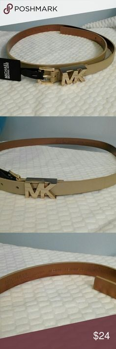M Michael Kors Belt NWT! Size M New with tags, never worn Michael Kors belt. Size medium. Gold hardware. The MK is smooth, the towel pattern is reflecting in the picture. The belt itself has some shiner to it. I chose cream as the color, but it's more of an extremely light gold. Michael Kors Accessories Belts