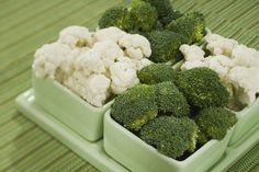 Small dishes of broccoli and cauliflower