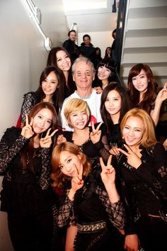 Bill Murray surrounded by the members of the hugely popular K-pop group, Girl's Generation. this my friends is Old Comedian Swag.