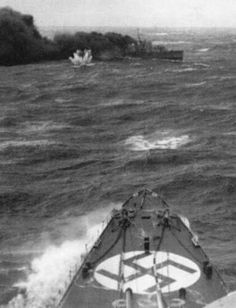 British destroyer HMS Glowworm emerging from her smoke screen prior to ramming the German heavy cruiser Admiral Hipper, 8 April 1940. 109 of the destroyer's 146 crew members were killed, including her captain, LCDR Gerard Broadmead Roope, who was awarded a posthumous Victoria Cross based on a communication from the German captain, sent through the Red Cross.
