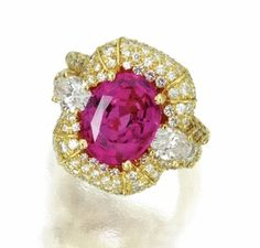 Pink cabochon sapphire and diamond ring set in 18k yellow gold from award-winning jewelry designer Henry Dunay, New York, New York....