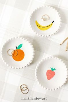 Rings, necklaces, earrings, even keys and coins—these little beauties will serve as catch-alls for it all. The clay dishes come with a pretty scalloped edge and decorative stick-on motif. #marthastewart #crafts #diyideas #easycrafts #jewelry