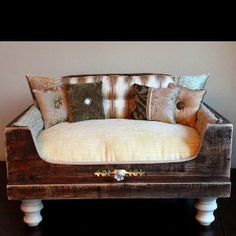 Royal cat bed - this appears to be a drawer with legs added; Pillows make the whole thing look cute!