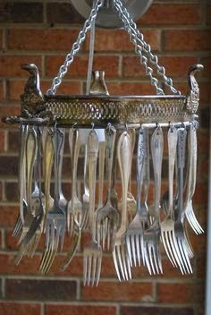 vintage silver forks wind chime. Upended casserole tray as round base (almost looks like a crow. When it's upside down).