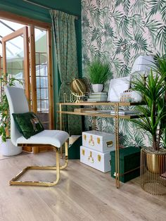 a bright and glam tropical home office with an accent wall, green and white boxes, a gold glass desk, brass planters and a glam chair - DigsDigs Gold Office Decor, Gold Bedroom Decor, Bedroom Green, Gold Bedroom Accents, White And Brown Bedroom, Mesa Home Office, Home Office Desks, Office Set, Living Room Green