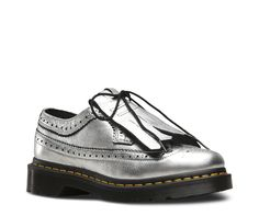 First made in the mid-'60s, the 3989 Brogue shoe features a unique combo of wingtip style with AirWair™ Bouncing Soles — a rebellious union of proper menswear and counterculture attitude. Now, it's taken a toughly feminine turn, with a removable kiltie and an allover silvery shine. An iconic style, this 3989 still serves up classic Doc's DNA, like grooved edges and yellow stitching. Built to last, this shoe is made using one of the finest methods of construction: the Goodyear Welt...