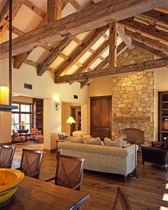 Barn-house idea: Wide open spaces, exposed beams, and soaring stone fireplace. From JMA - mediterranean - living room - san francisco - JMA (Jim Murphy and Associates)