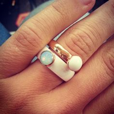 Melano jewerly, white ceramic ring with a aqua diamond and a rose gold ring with a pearl white stone.