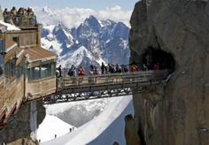 Aiguille-du-Midi-Bridge in France--getting here requires taking a cable car that climbs vertical feet in just 20 minutes. Where: The summit of Aiguille du Midi in the Mont Blanc massif near Chamonix. The Places Youll Go, Places To See, Scary Bridges, Chamonix Mont Blanc, Sky Bridge, Famous Bridges, Ville France, France Photos, French Alps