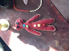 cranberry and oatmeal colored poppet (voodoo doll) includes a crystal chip inside to help amplify your work.
