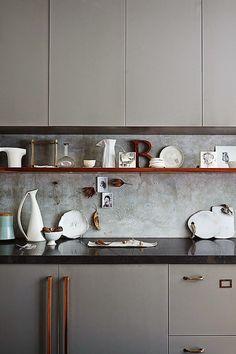 concrete backsplash and nice minimalistic cabinet doors