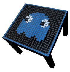 Retro Pixel Tables. Pac Man, megaman, galaxian Mosaic Coffee Table. $130.00, via Etsy.