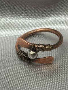 A personal favorite from my Etsy shop https://www.etsy.com/listing/556986081/copper-ring-size-85-copper-paddle-ring