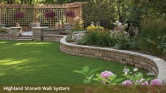 Stone wall - should try this on the back of the garage - raise the bed and use the stone wall.