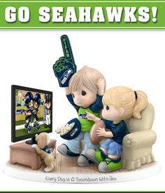 A first ever! Limited-edition NFL-licensed Precious Moments figurine celebrates Seahawks and your sweetheart.