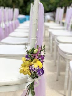 The theme was lilac and yellow. We used beautiful yellow billy balls teamed with purple lisianthus and lilac chiffon chair decoration. Wedding Chair Decorations, Wedding Chairs, Yellow Wedding, Summer Wedding, Destination Wedding Planner, Wedding Planning, Wedding Isles, Billy Balls, Purple Flowers