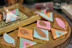 Adorable feather cookies! Whimsical Woodland Camping 1st Birthday Party via Kara's Party Ideas | KarasPartyIdeas.com