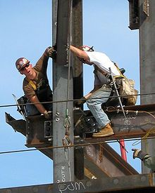 Ironworkers surprised by photographer, while erecting the steel frame of a new building, at the Massachusetts General Hospital, USA