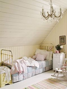 Iron bed and sweet patchwork quilt and soft colors in little girl's room. Helgensen home in Bergen.