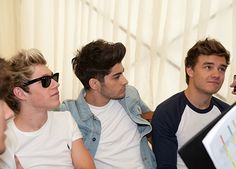 Niall's all cool with his stunna shades. Zayn's admiring Liam. Liam's being adorable.